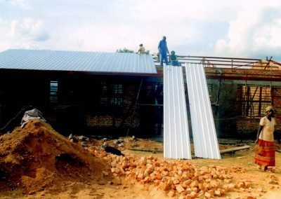 Completion of metal roof on classrooms.