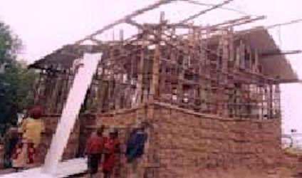 Sixbert's house with the roof being put in place